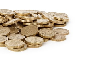 Pound coins on a desk