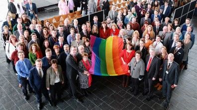 photo - LGBT staff and allies with the rainbow flag